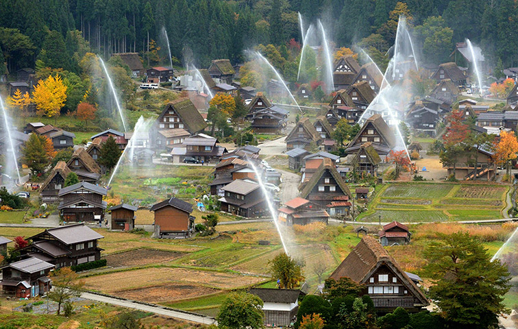 Water is sprayed at Shirakawa-go World Heritage site